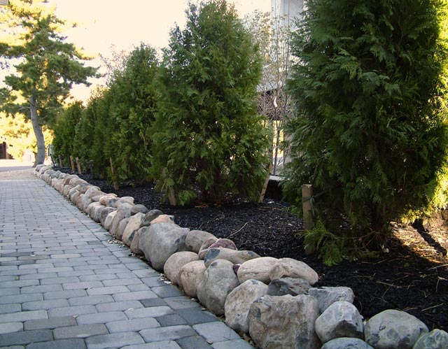 New house construction landscaping for Large river rock landscaping
